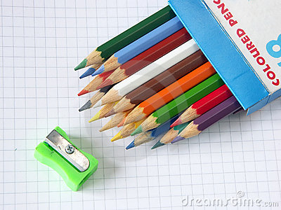Box of colored pencils and sharpener