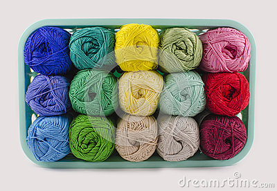 Box with colorful knitting yarn