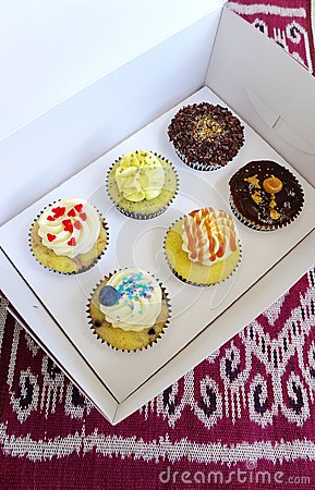 Box of cup cakes in take away carrying box