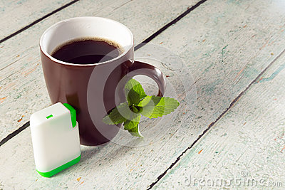 Box of stevia tablets and coffee