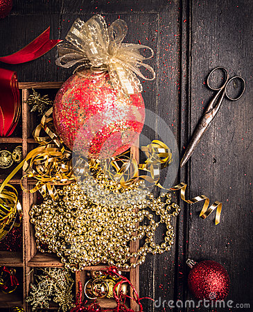 Free Box With Decorations For Christmas Trees With Old  Scissors  On Dark Wooden Background Royalty Free Stock Photo - 48190365