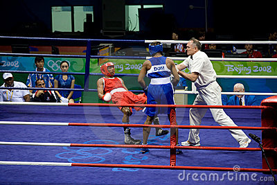 Boxer falls during Olympic bout Editorial Photography