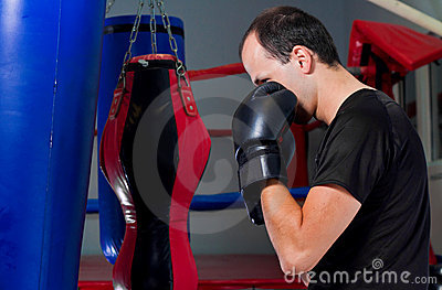 Boxer training with a sand bag