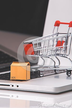 Free Boxes In And Trolley On A Laptop Online Shopping Is A Form Of Electronic Commerce That Allows Consumers To Directly Buy Stock Image - 139158521