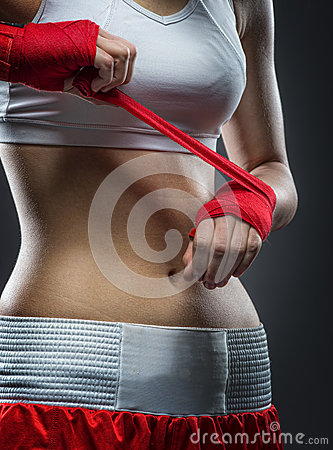 Boxing woman binds the bandage on his hand, before training, detail photo Stock Photo