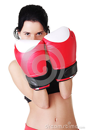 Boxing woman wearing red boxing gloves.