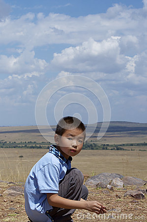 Boy in the African wilderness landscape