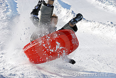 Boy in the Air While Sledding Downhill