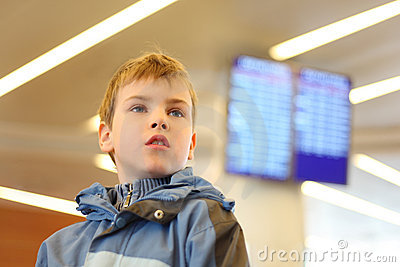 Boy in airport looking into distance