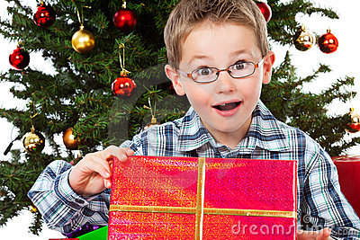 Boy amazed of the content of his christmas gift