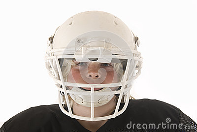 Boy in American football helmet