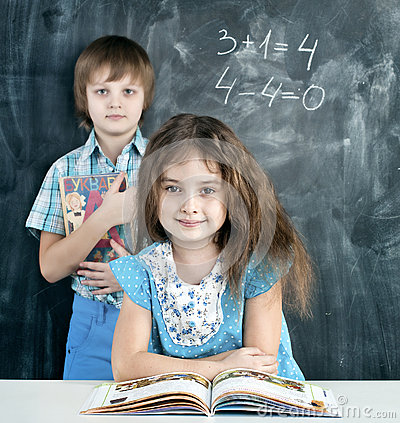 Free Boy And Girl In Classroom Stock Image - 38645851