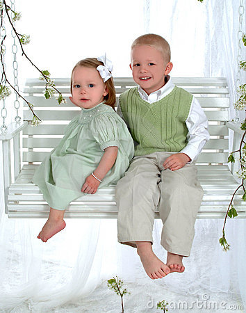 Free Boy And Girl On Swing Royalty Free Stock Photography - 4847057