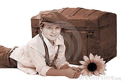 Boy and antique trunk