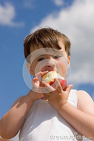 The boy with an apple
