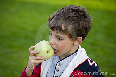 Boy with apple and ball