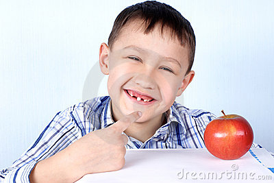 Boy with apple without several tooth s
