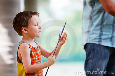 Boy with archery arrow