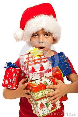 Boy with arms full of Xmas gifts