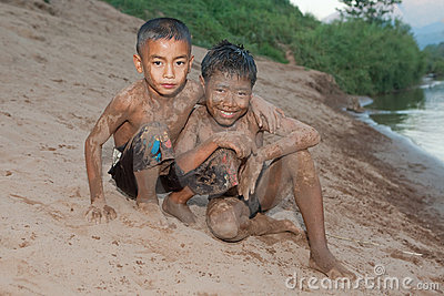 Boy of Asia with sand in the face