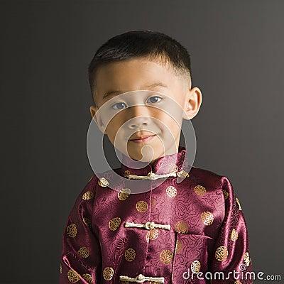 Boy in Asian attire.