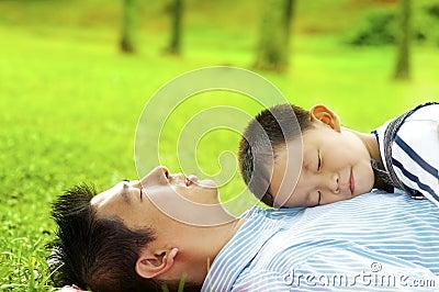 Boy asleep on dad s chest