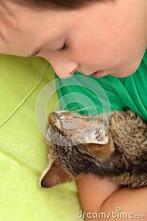 Boy asleep with his kitten