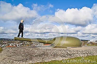 Boy balancing on a cannon