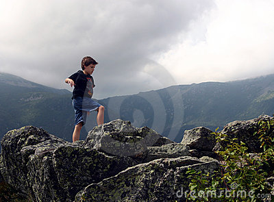 Boy Balancing on Rocks