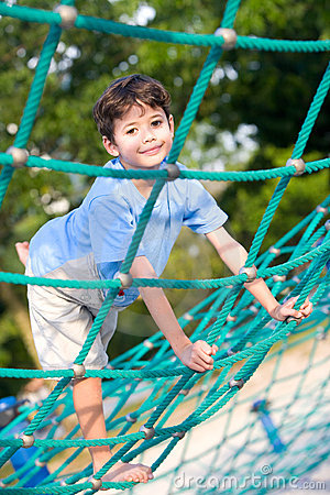 boy balancing on rope activity