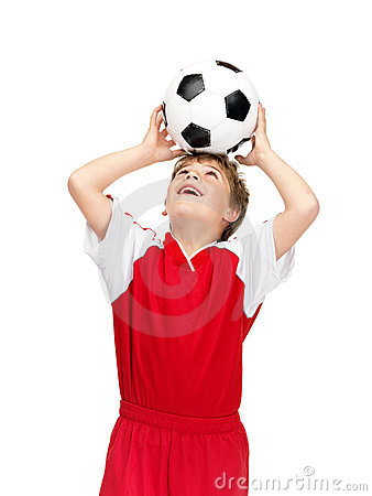 Boy balancing the soccerball on his head