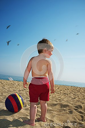 Boy with ball on a beach