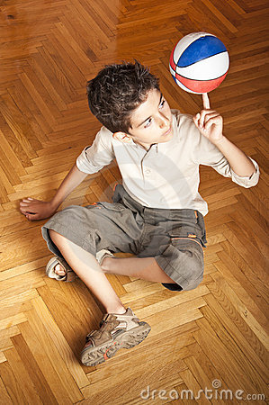 Boy with ball in equilibrium