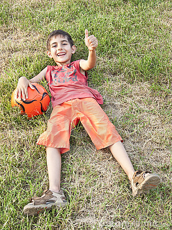 Boy with ball and thumb up
