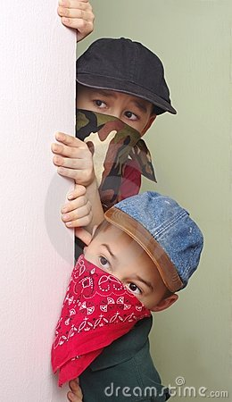 Boy bandits sneaking around corner