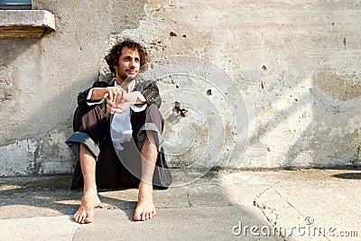 Boy barefoot, thinking