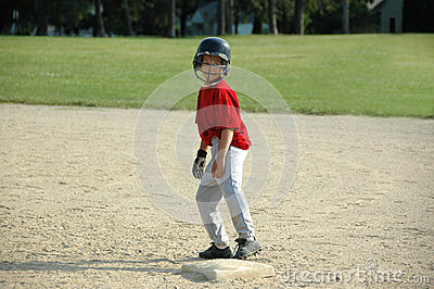 Boy on base in baseball game