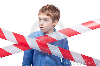 Boy behind cordon tape