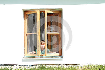Boy behind in the window