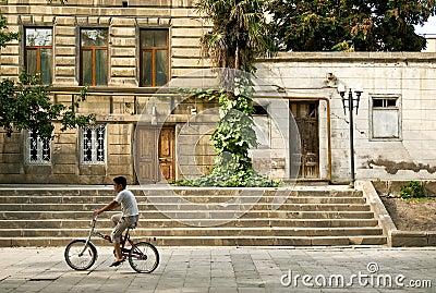 Boy on bicycle in baku azerbaijan Editorial Photo