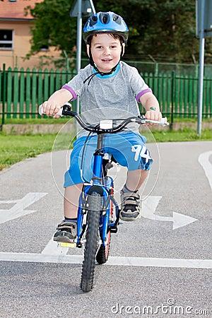 Boy on bicycling