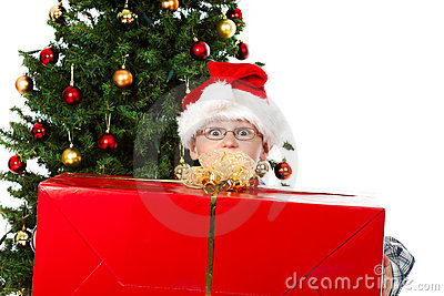 Boy with big christmas gift and eyes wide open
