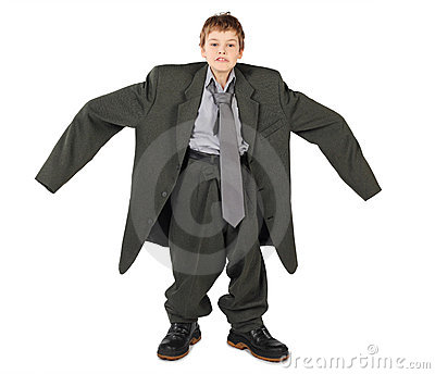 Boy in big man s suit and boots nads at sides