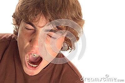 Boy with big yawn
