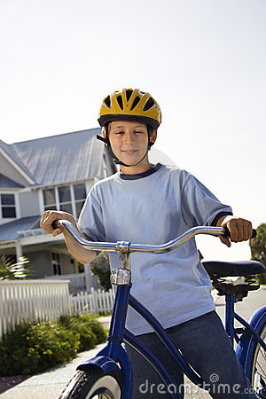 Boy on bike.