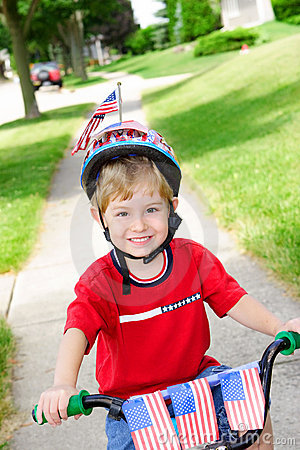 Boy on a bike on the 4th of July
