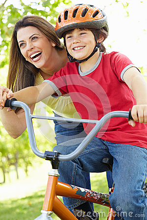 Boy on bike with mother