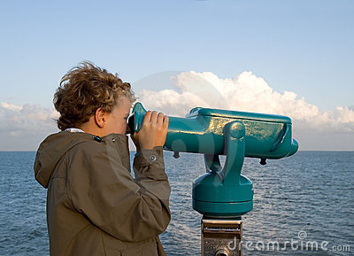 Boy at binoculars