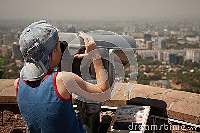 Boy with binoculars.