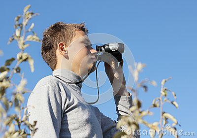 Boy with binoculars in hand